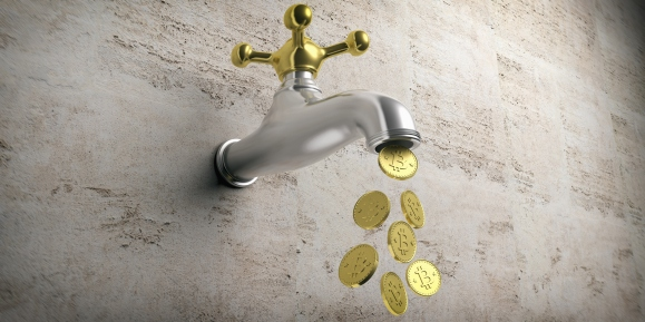 Bitcoins falling out from a golden silver faucet on beige background.